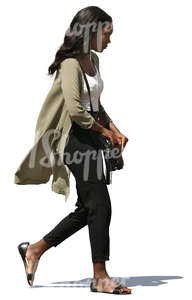 young african woman walking on the street