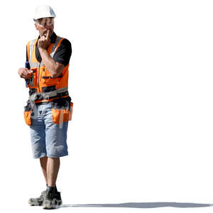 worker with an helmet standing and thinking