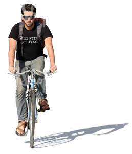 young man riding a bike in summertime