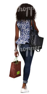 black woman with shopping bags walking down the street