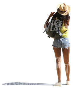 black woman with a hat and shorts standing
