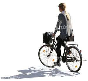 backlit woman riding a bike