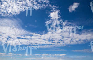 daytime sky with scattered clouds