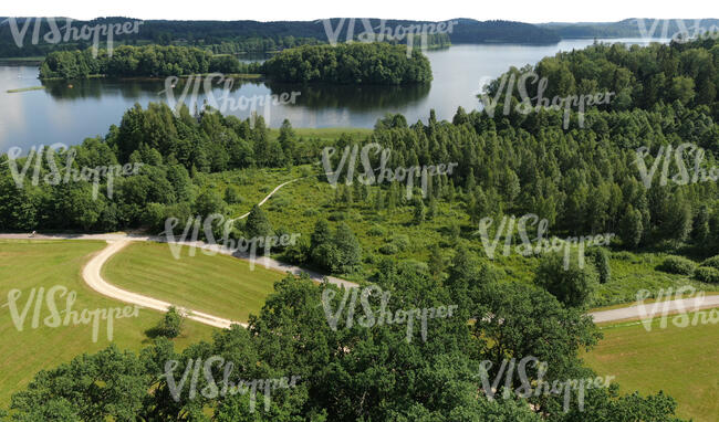 cut out bird eye view of a beautiful rural landscape with a lake