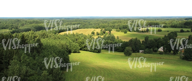 aerial view of a landscape of meadows and trees
