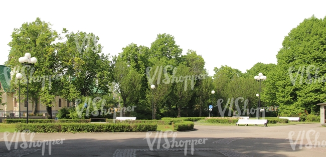 view of a park with benches and street lamps