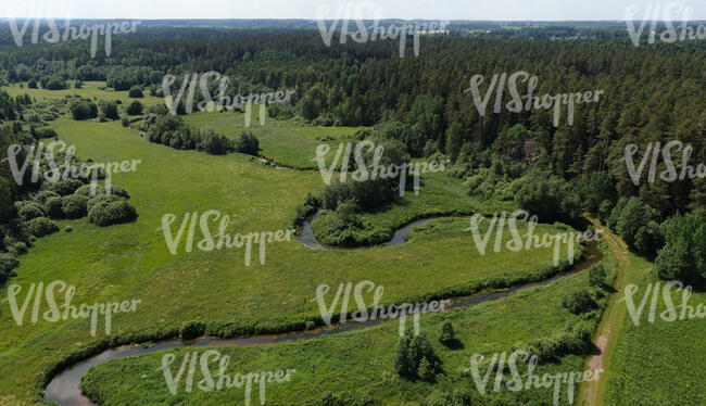 aerial view of a countryside with river and forests