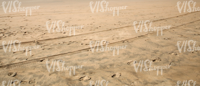 sandy beach with tracks and footprints