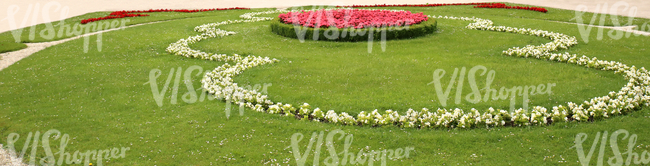 park ground with pink and white formal flowerbeds