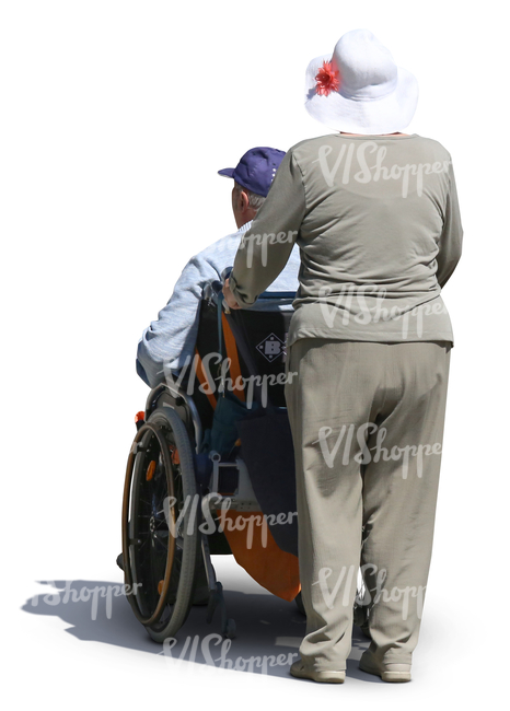 elderly woman pushing a man in a wheelchair