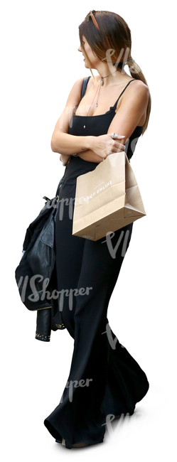 woman in a black outfit and carrying shopping bags