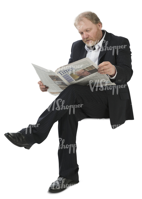 man in a suit sitting and reading a newspaper