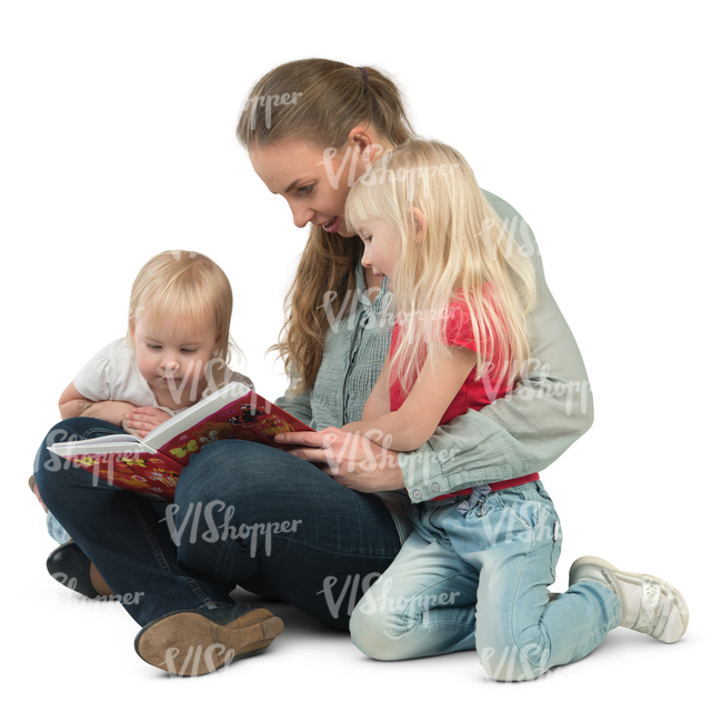 woman with her two daughters sitting on the floor and reading a book