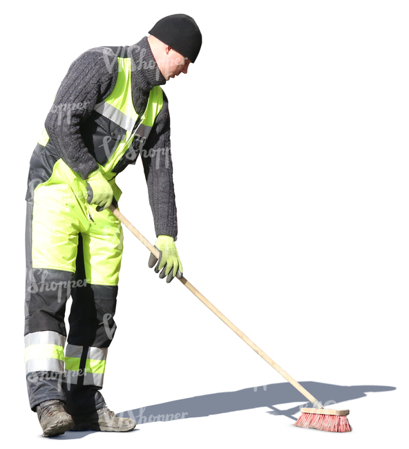 man with street brush doing spring cleaning