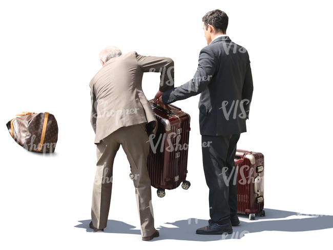 hotel porter and taxi driver loading bags in the trunk