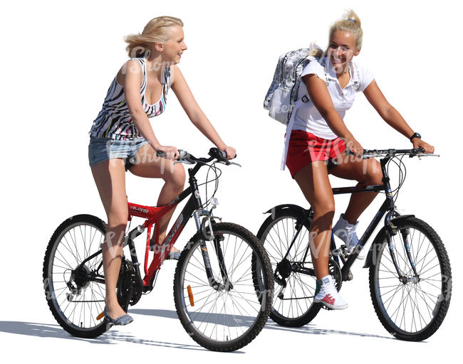 two women riding on bikes and talking
