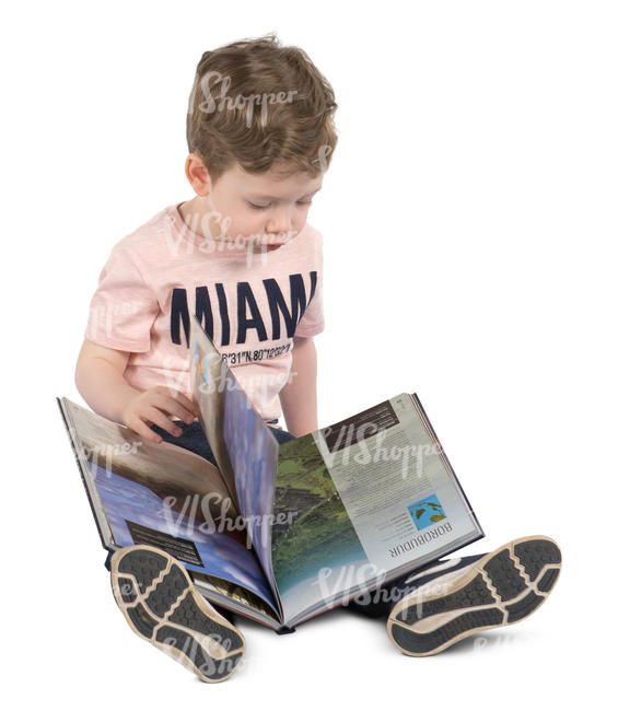boy sitting on the floor with a book
