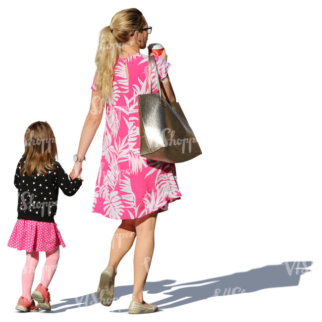 mother and daughter in summer dresses walking hand in hand