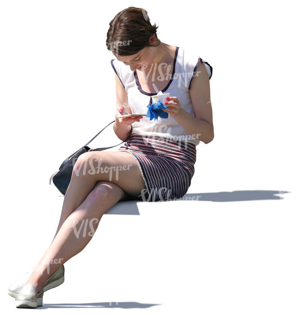 woman sitting and eating ice cream