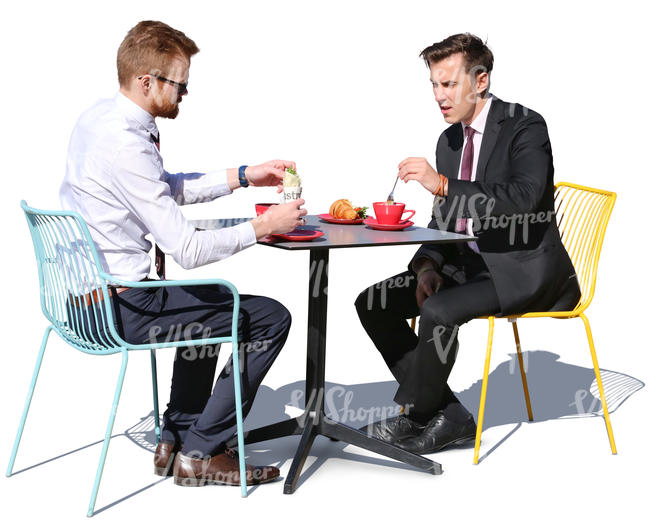 two businessmen having a lunch in a cafe