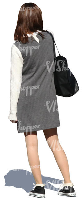 cut out asian woman in a grey dress standing