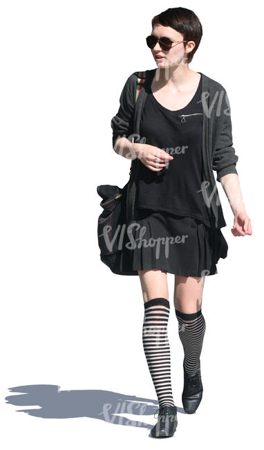 cut out woman in a black outfit walking