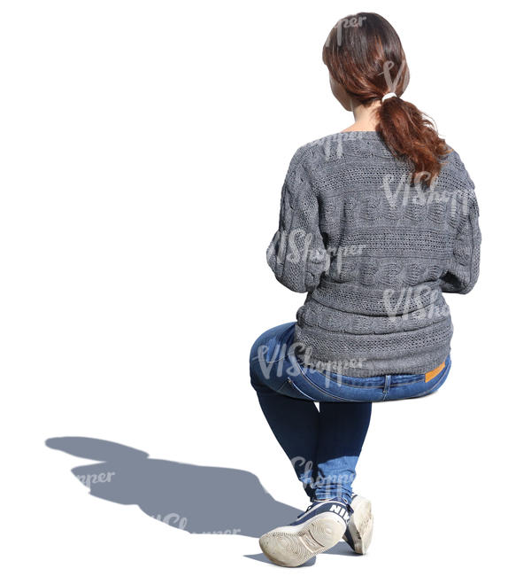 woman in a grey sweater sitting