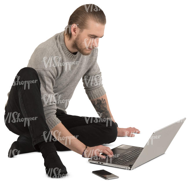 man sitting on the floor and working with laptop