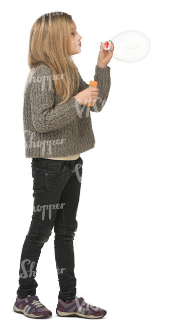 young girl standing and blowing soap bubbles