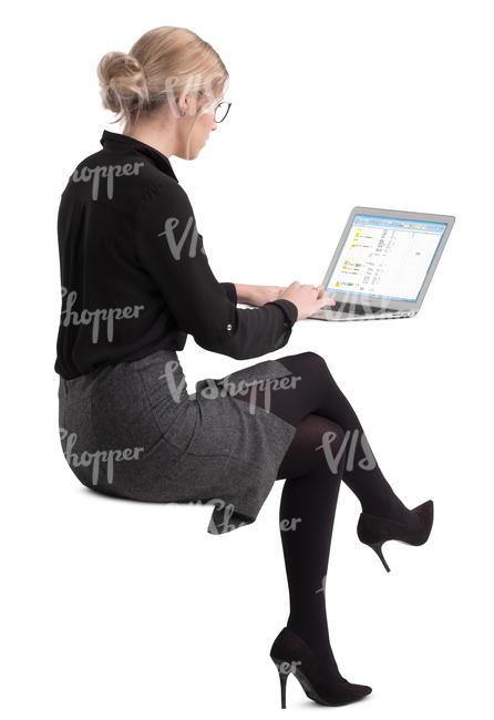 woman sitting at an office table and working