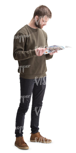 man standing and reading a magazine