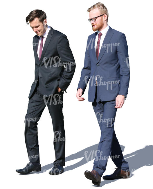 two men in suits walking and talking