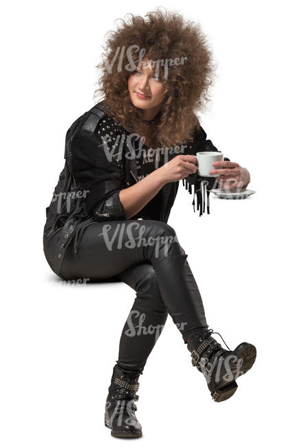 woman with big hair sitting in a cafe