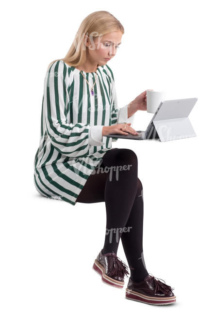 woman in a striped dress sitting behind a desk