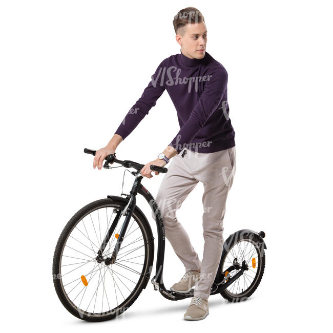 young man riding a kickbike