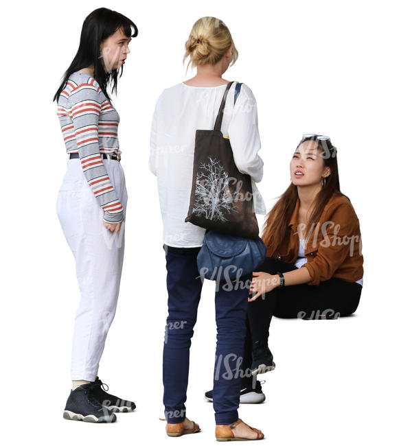 three women standing and talking