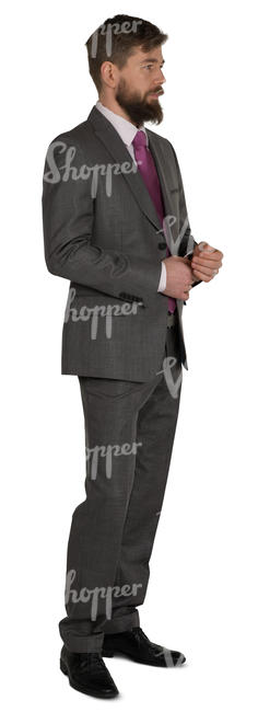 man in a grey suit standing and looking