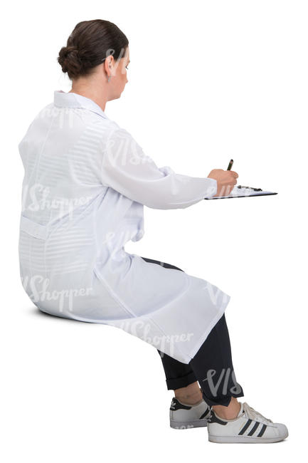 female doctor sitting and writing