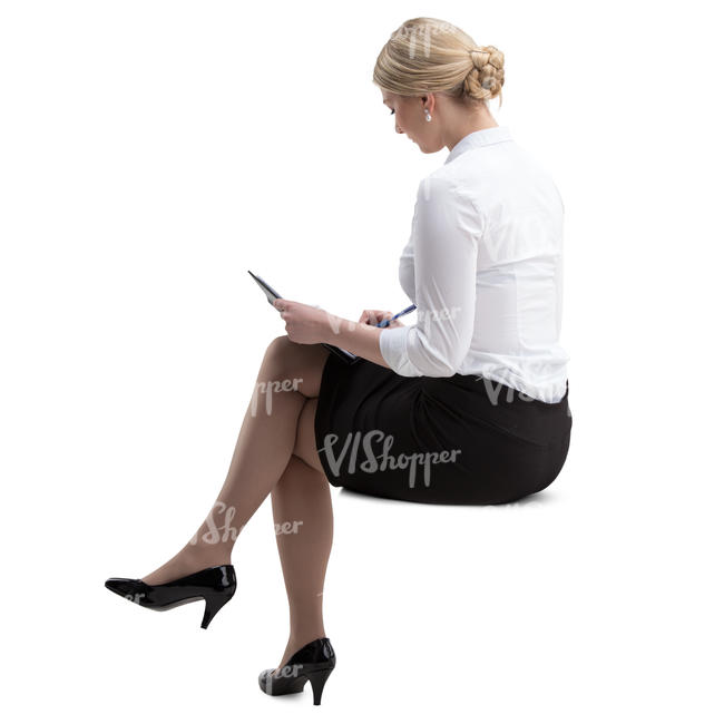 businesswoman sitting and taking notes