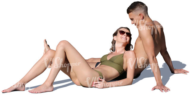 young man and woman relaxing on the beach