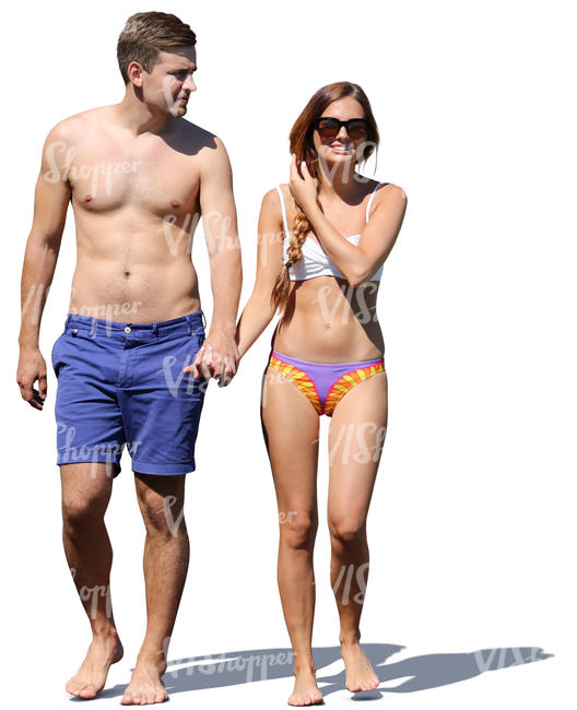 couple in bathing suits walking hand in hand