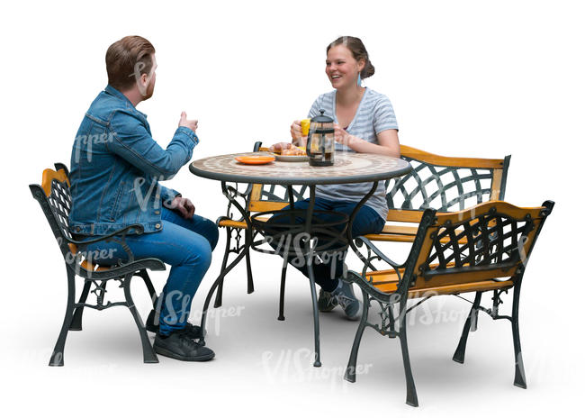 man and woman sitting at a terrace table and drinking coffee