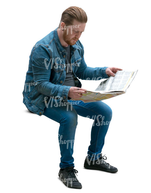 man sitting and reading a newspaper