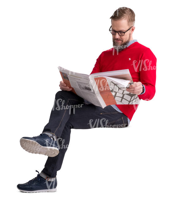 man in a red sweater sitting and reading