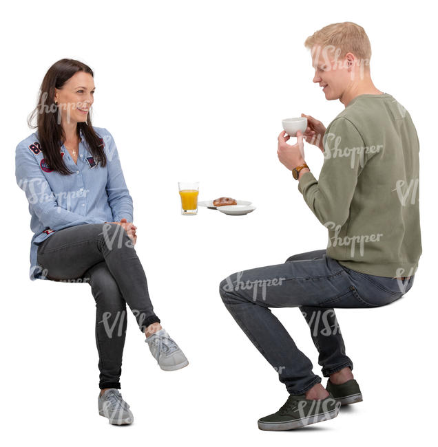 man and woman sitting and talking in a cafe