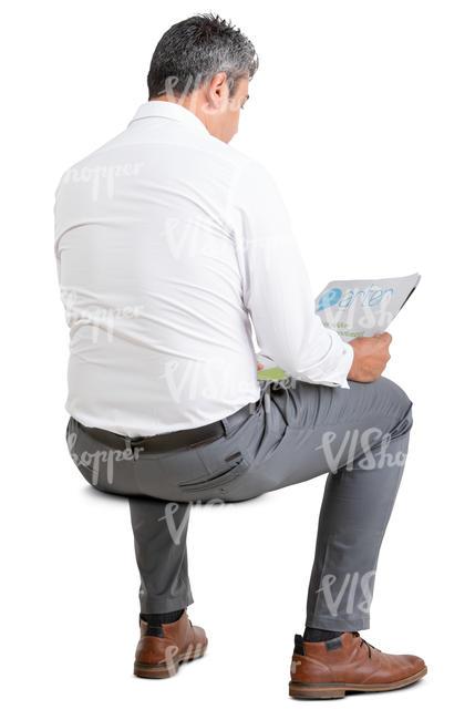 businessman sitting and reading a newspaper