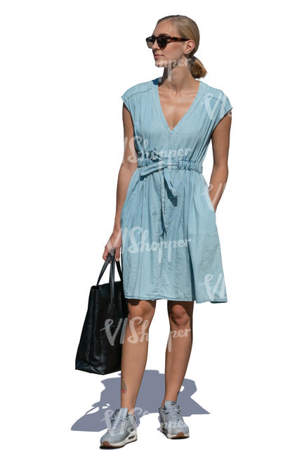 woman in a light blue summer dress standing