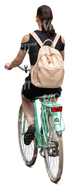 woman with a backpack riding a bicycle