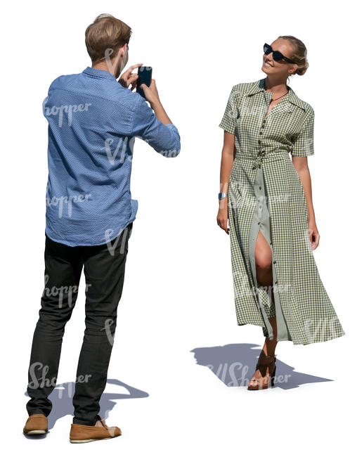 man taking a picture of a woman
