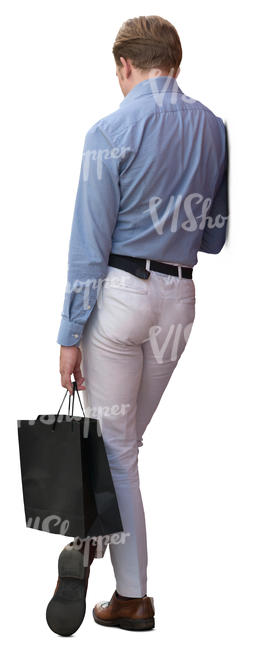 man with a shopping bag leaning against the wall